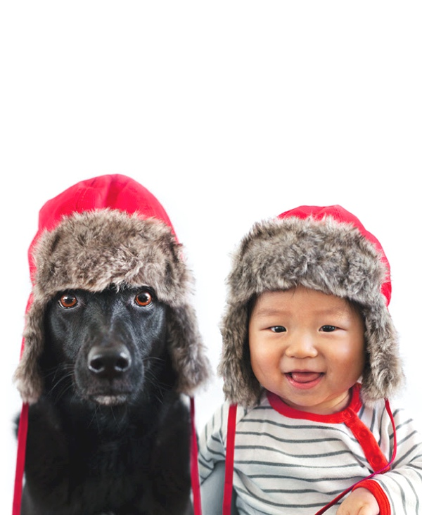 A Baby and A Rescue Dog  red hat