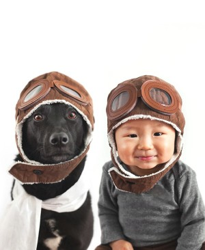 A Baby and A Rescue Dog same aviator hat